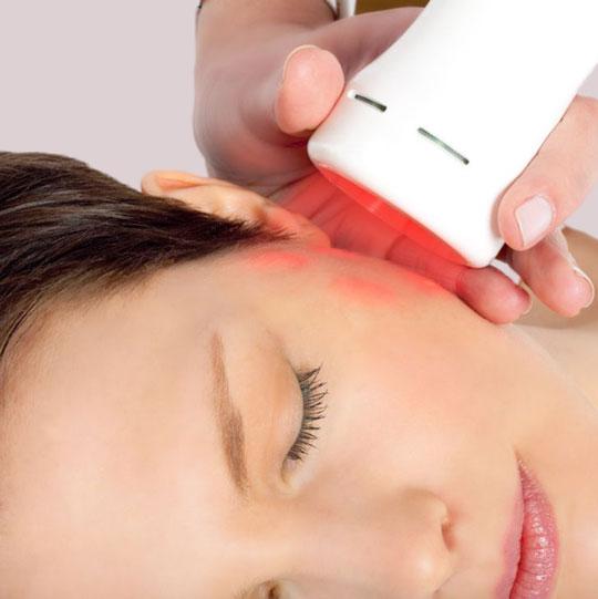 A woman receiving Byonik Laser treatment