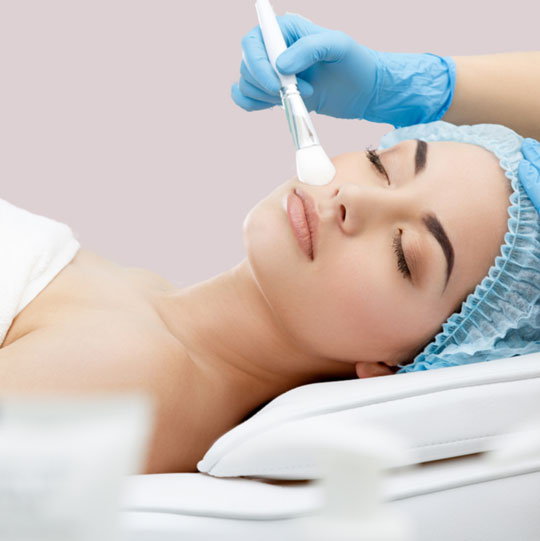 Image of a woman receiving Chemical Peels treatment