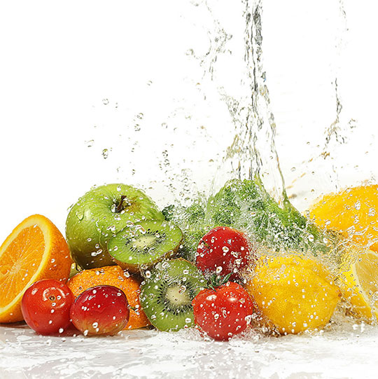 Image of fruit being splashed with purified water